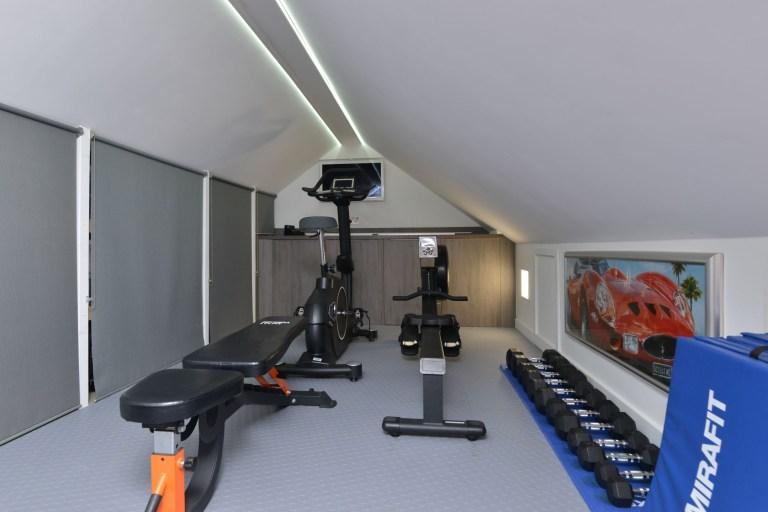 garage in hillside home with gym