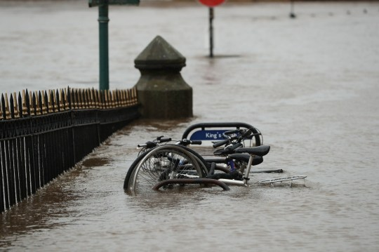 Partially submerged bicycles in a flooded part of York, in anticipation of Storm Christoph which is set to bring further flooding, gales and snow to parts of the UK. Heavy rain is expected to hit the UK, with the Met Office warning homes and businesses are likely to be flooded, causing damage to some buildings. Picture date: Wednesday January 20, 2021. PA Photo. People are being urged to prepare as an amber weather warning for rain was issued for Tuesday to Thursday affecting an area around Manchester, Leeds and Sheffield and stretching down to Peterborough. Photo credit should read: Danny Lawson/PA Wire