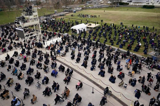 Guests attend the 59th Presidential Inauguration at the U.S. Capitol in Washington, Wednesday, Jan. 20, 2021. (AP Photo/Carolyn Kaster)