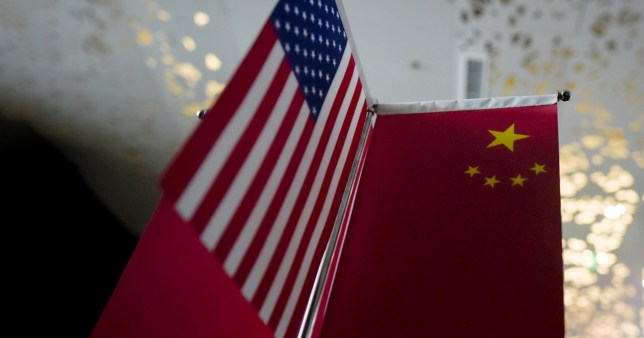 An American and Chinese flag next to each other (AFP via Getty Images)