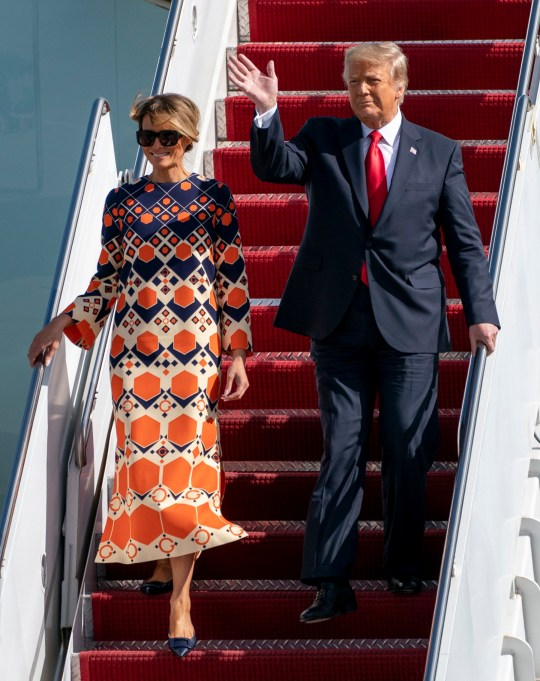 Melania and Donald Trump getting off Air Force One for the final time