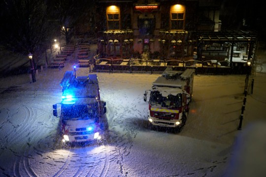 Fire trucks in the snow in Manchester