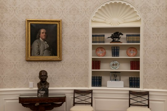The Oval Office of the White House is newly redecorated for the first day of President Joe Biden's administration, Wednesday, Jan. 20, 2021, in Washington. On the the table is a bust of former President Harry Truman. (AP Photo/Alex Brandon)