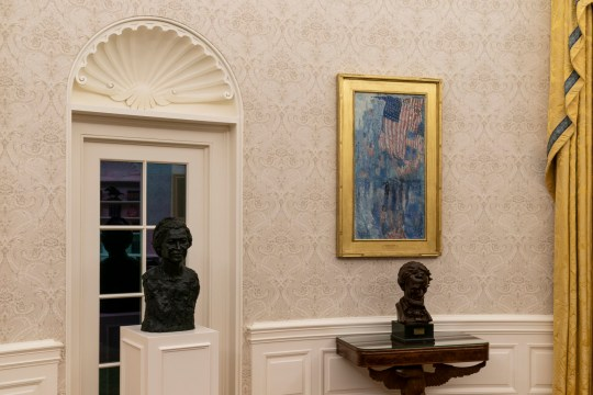 The Oval Office of the White House is newly redecorated for the first day of President Joe Biden's administration, including busts of civil rights leader Rosa Parks, left, and President Abraham Lincoln, Wednesday, Jan. 20, 2021, in Washington. (AP Photo/Alex Brandon)