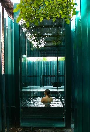 Stay in a glass-walled room with private onsen at this unique hotel in Spain
