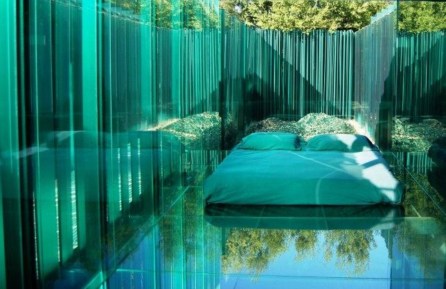 Stay in a glass-walled room with private onsen at this unique hotel in Spain credit: Les Cols Pavellons