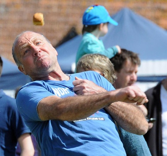 Mandatory Credit: Photo by Geoff Moore/REX (2324799a) A man competes in the event Annual Dorset Knob-Throwing Festival in Cattistock Village, Dorset, Britain - 05 May 2013 The biscuit that lands the furthest away without breaking is the winner