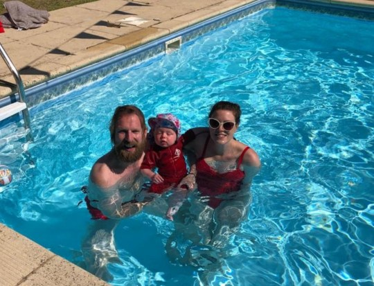 SANDERSON JONES, 40, WITH WIFE IMOGEN MOORE-SHELLEY, 32, WITH THEIR ONE-YEAR-OLD DAVEY JONES
