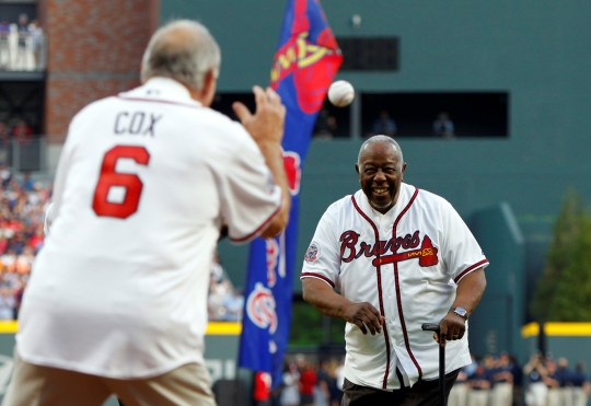 FILE PHOTO: Apr 14, 2017; Atlanta, GA, USA; Atlanta Braves legend Hank Aaron throws the ceremonial first pitch to former manager Bobby Cox prior to the first MLB game at SunTrust Park. Mandatory Credit: Brett Davis-USA TODAY Sports/File Photo