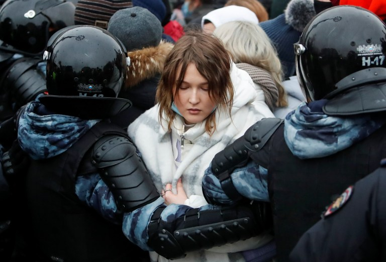 Law enforcement officers detain a woman during a rally in support of jailed Russian opposition leader Alexei Navalny in Moscow, Russia January 23, 2021. REUTERS/Maxim Shemetov