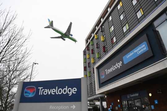 epa08966491 A plane flies over a Travelodge Hotel near Heathrow Airport near London, Britain, 26 January 2021. The British government is expected to approve a plan to require UK citizens to quarantine in a hotel if they arrive in England from high-risk countries. EPA/NEIL HALL