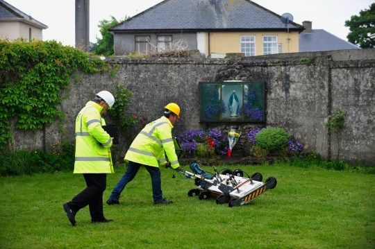 Engineers using ground penetrating radar at the site of a mass grave of up to 800 children at the former Mother and Baby home in Tuam, County Galway, in western Ireland. It was revealed 3 March 2017 by the Mother and Baby Homes Commission that a mass grave containing the remains of babies has been discovered at the former orphanage. The commission announced that excavations at the site in Tuam found 20 chambers underground containing large quanitites of human remains. EPA/AIDAN CRAWLEYepa05827245 (FILE)