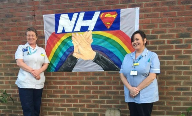 Eileen Blake standing next to a sign that says 'NHS'