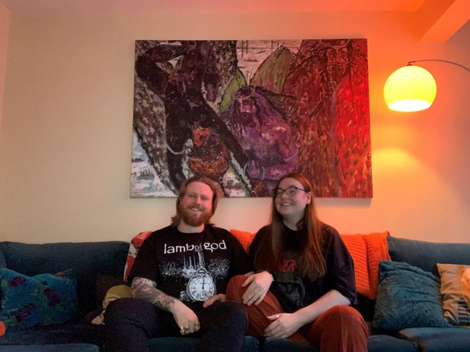 iona and jack on their sofa in their four-bedroom house in Oldham, Manchester