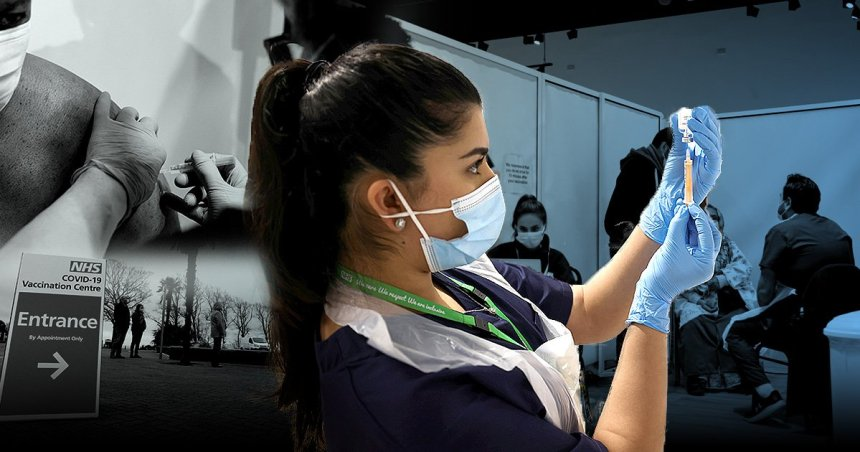 A nurse prepares to administer the Covid vaccine