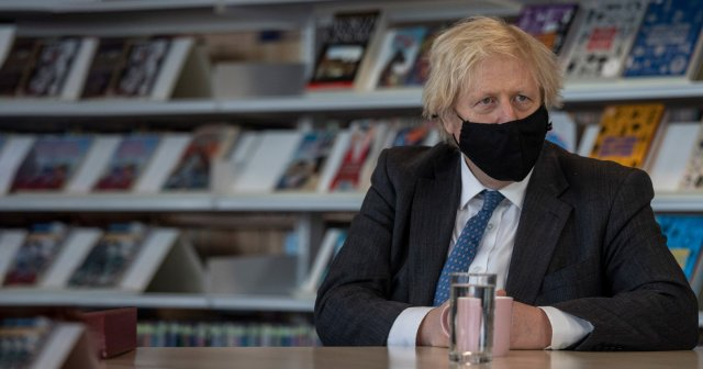 Boris Johnson wears a facemask as he visits a school during lockdown