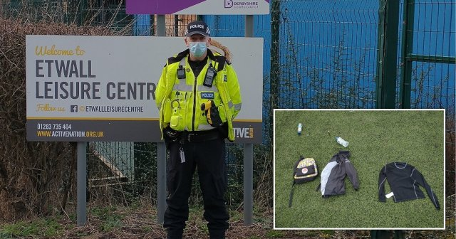 A police officer stands guard at a leisure centre where 20 children were caught playing football
