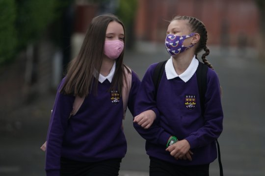 Kadie Lane (right), 11, and Brooke Howourth, 11, walking to Marden Bridge Middle School in Whitley Bay, Tyne and Wear, for their first day of term, as schools in England reopen to pupils following the coronavirus lockdown. PA Photo. Picture date: Wednesday September 2, 2020. More than a quarter of parents said they were not planning to send their child back to school at the start of term, while a further 20 percent remained undecided, according to a poll by the charity Parentkind. See PA story EDUCATION Schools. Photo credit should read: Joe Giddens/PA Wire