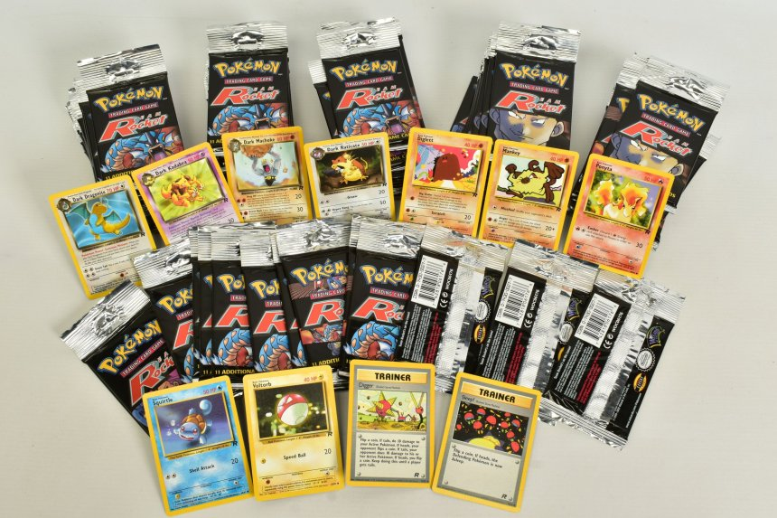 The auction includes 70 sealed Pokemon Team Rocket booster packs