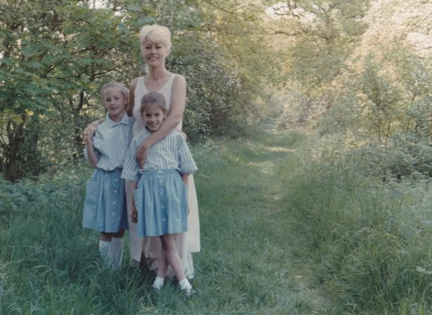 Caroline (front) pictured in the arms of her mother Christine and with twin Jody / CAPTION: Caroline Flack's family share photos of her as smiling teen Caroline Flack is smiling widely in a photo of herself as a teenager, in one of a number of rare snaps released ahead of the airing of her documentary. Love Island star Caroline, who was 40 when she tragically took her own life last year, will be the focus in a new Channel 4 doc, called Caroline Flack: Her Life and Death, which her mother Christine has taken part in to pay tribute to her talented daughter. It is not known when Caroline Flack: Her Life and Death will air, but her family has now released a number of rare, touching images of the TV star from her childhood ahead of the release date, after an emotional trailer for the doc was released. One photo sees a fresh-faced Caroline smiling widely as she sits side on to the camera, for a school snap in taken the 1990s. RIP FROM SITE: https://www.ok.co.uk/celebrity-news/caroline-flack-photos-death-documentary-23545783