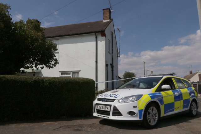 Police outside a home in Rochford, Essex, England after Christina Acres drowned her son George in the bath on July 23, 2018