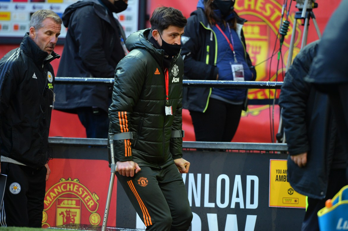 Harry Maguire walks with the aid of crutches after Manchester United's Premier League clash with Leicester