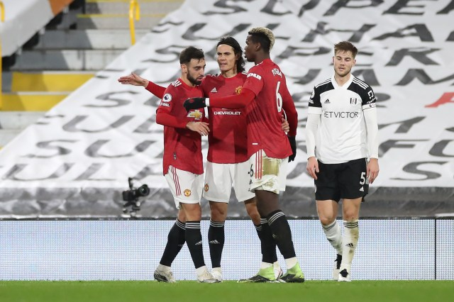 Bruno Fernandes celebrates with Edinson Cavani and Paul Pogba during Manchester United's Premier League clash with Fulham