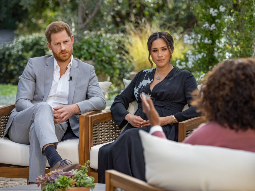 In this handout image provided by Harpo Productions and released on March 5, 2021, Oprah Winfrey interviews Prince Harry and Meghan Markle on A CBS Primetime Special premiering on CBS on March 7, 2021. (Photo by Harpo Productions/Joe Pugliese via Getty Images) - 9340455