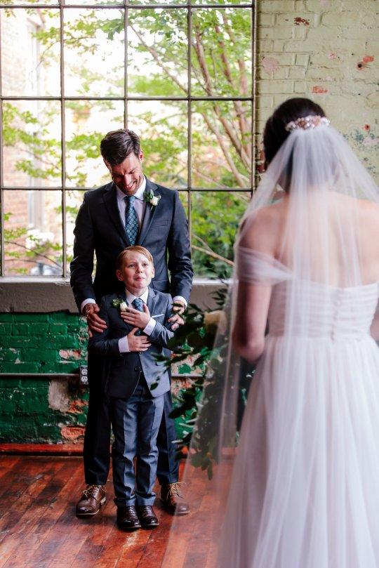 These images show the delightful moment that ten-year-old Jew Seabolt burst into tears after seeing his new stepmother Rebekah Seabolt in her wedding dress at her wedding to his father Tyler Seabolt.  Monroe, Georgia, USA