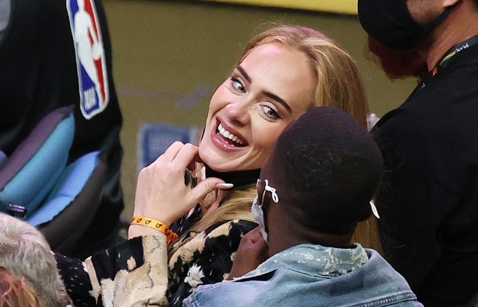 Singer Adele smiles during the second half in Game Five of the NBA Finals between the Milwaukee Bucks and the Phoenix Suns at Footprint Center on July 17, 2021 in Phoenix, Arizona.