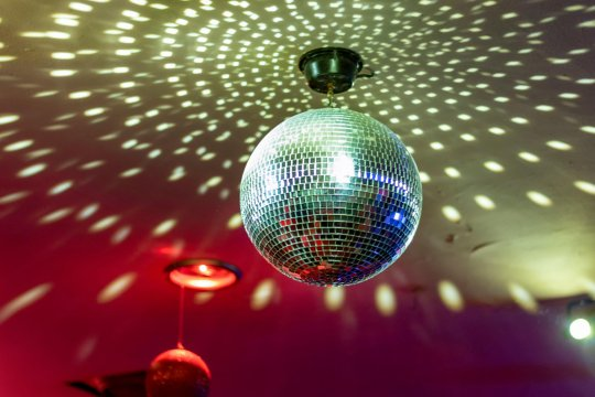 2AHGJ4J Disco ball with bright rays, night party background photo