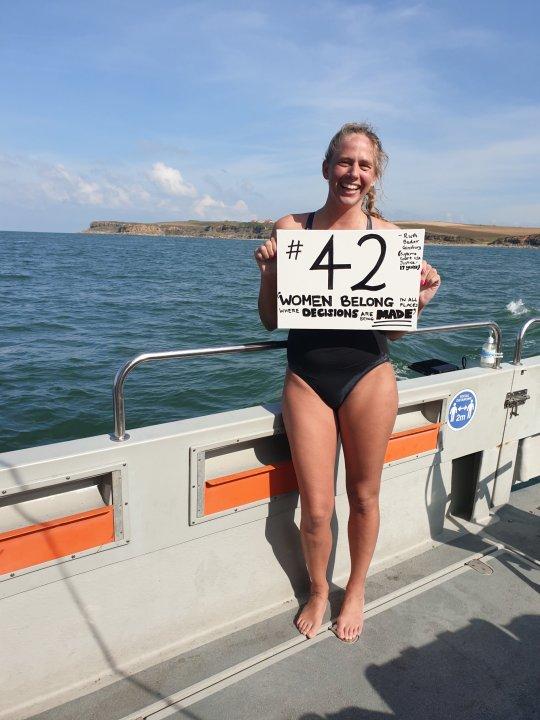 Chloë McCardel holding up #42 sign