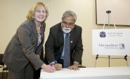 Metropolitan State Interim President Dr. Devinder Malhotra and North Hennepin Community College President Dr. Barbara McDonald on March 3, 2016, sign an agreement that will allow students to work toward their bachelors degree at the NHCC Booklyn Park campus.