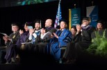 Commencement speakers seated on stage.