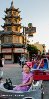 little girl in mechanical car