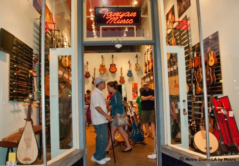 people in a musical instrument shop