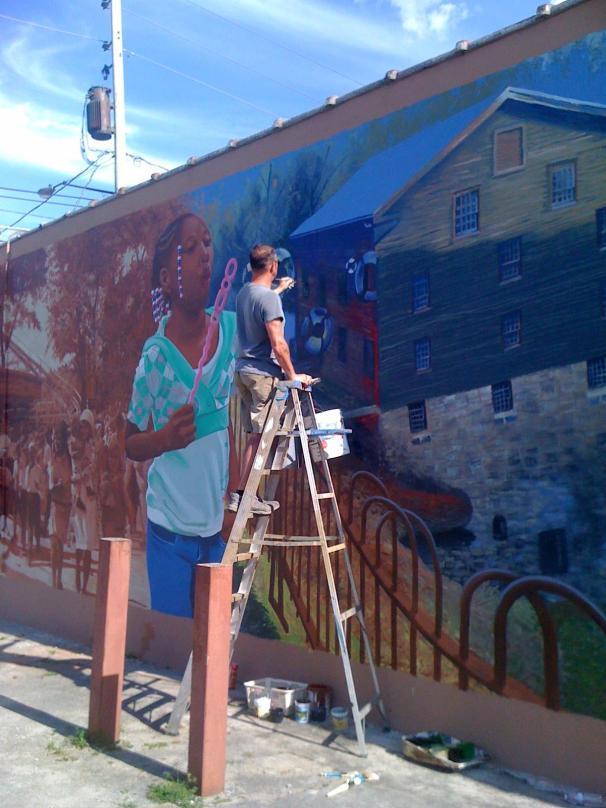 Idora neighborhood mural nears completion last summer.