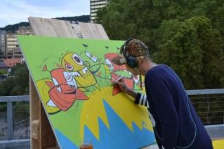 Graffiti Artist C-Line am Werk.