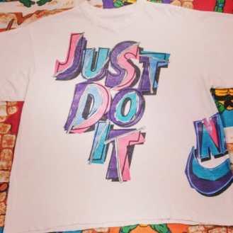 Just do it. #nike #niketshirt #90sfashion #vintagetshirts #justdoit #tribenyc #tribe