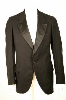 C. 1940s Black wool tuxedo jacket. Single button single breasted.
