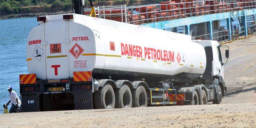 An oil tanker parking alongside a road