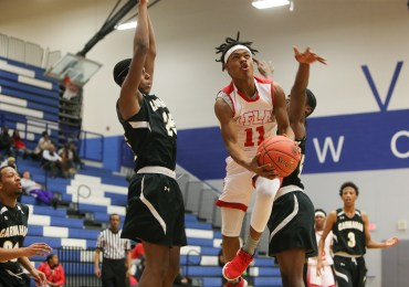 Late push lifts Hawks over Cougars