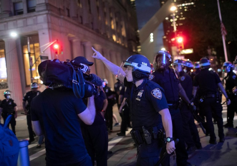 Police shove, make journalists stop covering protest