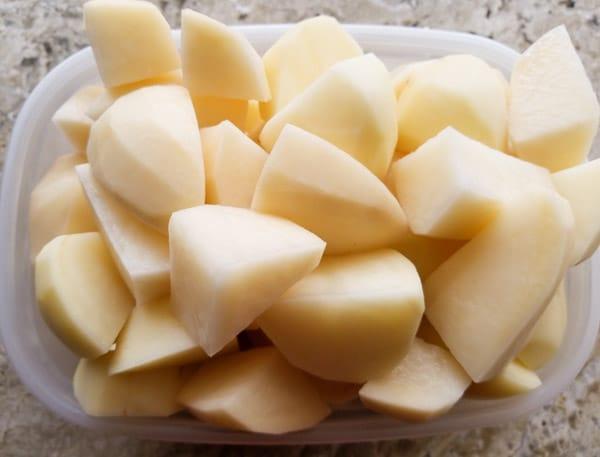 Potatoes quartered and ready to boil for the Rellenos de Papa (stuffed Potato Balls)
