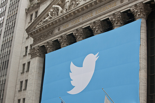 A Twitter Banner Draped Over The New York Stock Exchange For Twitter's IPO by Anthony Quintano