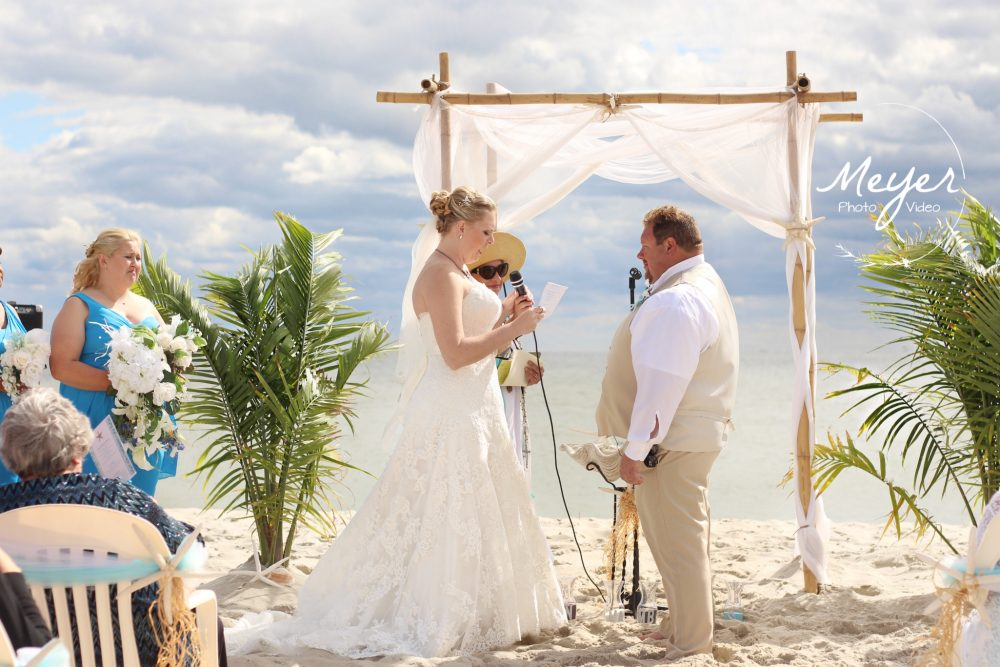 saying vows on the beach