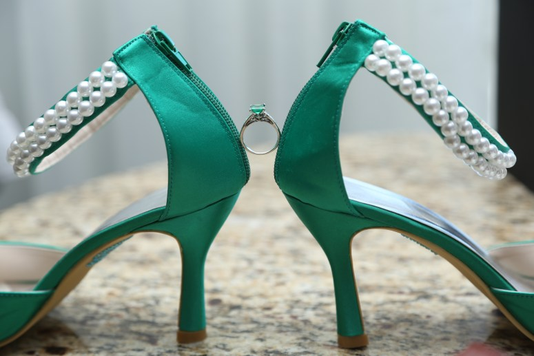 emerald engagement ring and green shoes wedding photo
