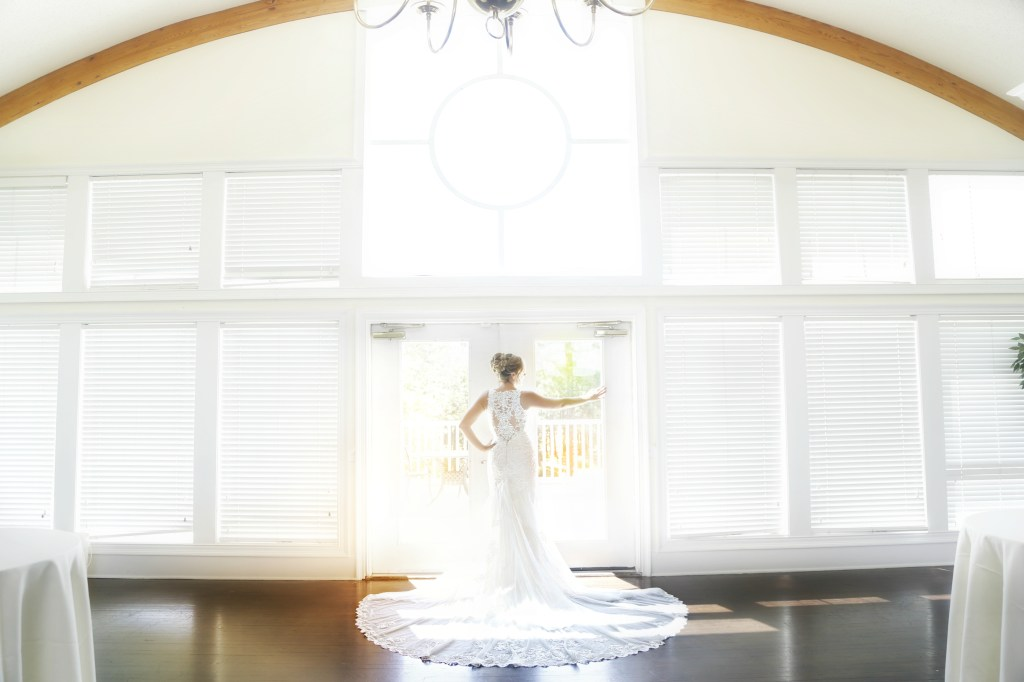 bride by windows