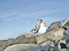 wedding couple at jersey shore on rocks