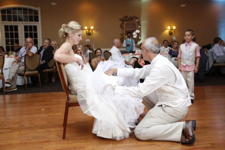 groom removing garter